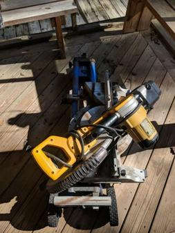 Dewalt compound sliding mitre table Saw With Rolling Stand